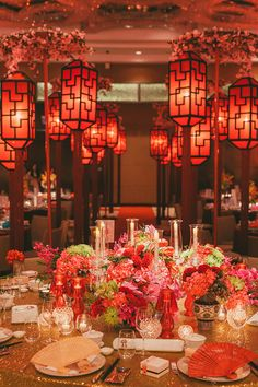 Red, pink and gold grand ballroom wedding with traditional Chinese lanterns, candles and table decor // Old Shanghai Glamour: Howard and Yi-Ann's Wedding at Grand Hyatt Kuala Lumpur