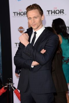"""Tom Hiddleston """"I'm pretty sure he's eyeing you across the room at a upper-crust cocktail function, and will appear anon at thine side to hold thy drink whilst thy cell phone is recovered from the depths of thy purse. And then he will ravish thee."""" Go Fug Yourself"""