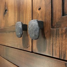 Set of 2 cabinet knobs (pair) hand forged from used railroad spikes. Cabinet Pulls are straight out of the forge with all the ugly numbers and markings hammered out and lightly brushed to leave a nicely rounded and antique looking wrought iron knob.