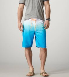 AE: What do you wear to the beach? Z: A white tee with swimming trunks, ready to throw that shirt off and jump in