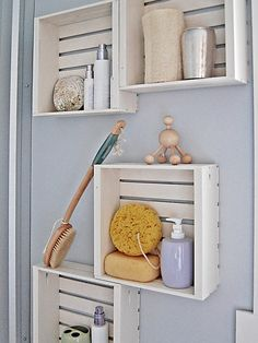 Adorn bathroom walls with painted crates to store toiletries. Loveeee the peaceful blue color of the walls!