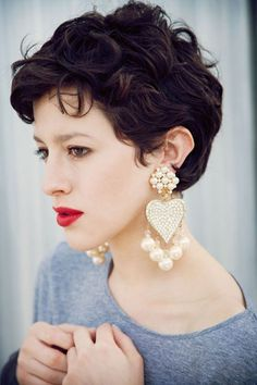 Short curly hair, wavy. Check out the earrings