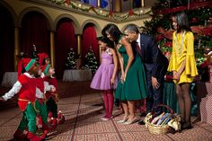President Barack Obama, First Lady Michelle Obama and daughters Sasha and Malia attend the Christmas in Washington taping at the National Building Museum in Washington, D.C., Dec. 11, 2011.