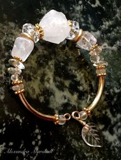 Love this memory wire single wrap bracelet from Alexandra Marshall featuring clear and frosty rock crystal nuggets and pebbles accented with permanently sealed gold plate. Adjusts to fit most wrists. #B2576.