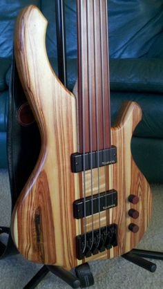 My boyfriend's bass guitar. Love the cherry and rose wood!