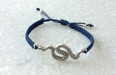 This macrame snake bracelet is hand knotted, made with dark blue 1mm knotting cord, antique silver tone snake connector and has  adjustable closure. Looks beautiful on its ... #etsysocial