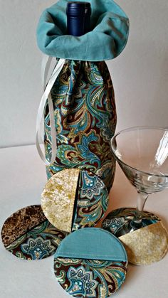 paisley wine gift bag hostess gift wine tote wine by FabuMimi Scrap Fabric Projects, Small Sewing Projects, Quilting Projects, Fabric Crafts, Sewing Crafts, Fabric Coasters, Glass Coasters, Quilted Gifts, Wine Tote