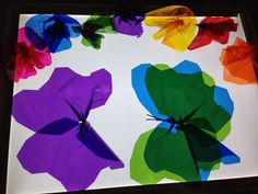 free hand cut butterflies from cello paper for the light table