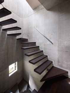 I love the contrast of the polished wood and the unfinished concrete.