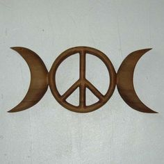 Triple Moon Peace Symbol-Celtic Goddess-Wiccan Pagan Peace Sign-Hippie MEANING: We've invited the Ancient Goddess of the Celts to join the Peace Movement! Coop has carved a peace symbol in the center full moon. For Hippie type Wiccans or Pagans who would like to focus their energy on Peace, whether it be world peace or inner peace...The Moon Phases  represent the aspects of the Goddess and the phases of the Life of Women: Waxing for The Maiden; Full for The Mother; Waning for The Crone…