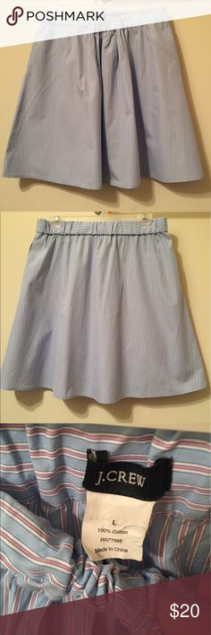 """J. Crew baby blue & pink pinstripe skater skirt J. Crew brand feminine baby blue skater skirt with thin pink & white pinstripes. Slight pleating to top of skirt & mild ruching to waistline. Elastic waistband can accommodate larger waists. Soft cotton feel. Skirt unlined but not see through. Has 2 functional deep pockets on each side of hips. EUC with no stains or rips. True size Large. Very flattering. Unstretched waist 32"""" & length 22"""". Open to reasonable offers. J. Crew Skirts Circle…"""