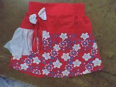 ropa de niña, falda short de niña con elastico en pretina y delantero estampado con corbatin y gola en tela viscosa
