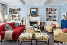 The walls are painted a subtle shade of blue, Benjamin Moore's Lookout Point, in a New York living room designed by Christopher Maya.