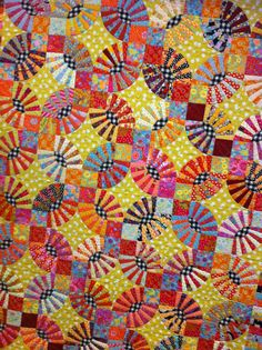 Seen at an Austin quilt show. Looks like a dish of candy! Love how the B&W centers pop against the bright colors.