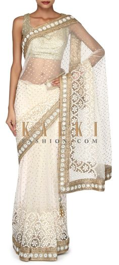 Buy Online from the link below. We ship worldwide (Free Shipping over US$100). Product SKU - 302895. Product Link - http://www.kalkifashion.com/off-white-saree-adorn-in-mirror-embroidered-border-only-on-kalki.html