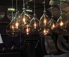 I recently discovered recycled glass bottles being repurposed into industrial lighting.  I think you will find these hanging recycled glass bottles really cool.  I have never seen this done before but I really like them!