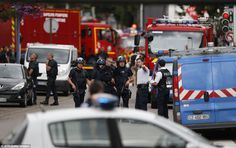 Police are still seeking the identity of the second attacker, and are continuing to carry out raids. Pictured, French officers and fire engines at the scene of the hostage taking