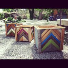 We have these at Sierra Water Gardens....idea found at this cool blog:  http://www.zelophotoblog.com/91204/chevron-pattern-recycled-wood-planter-box/