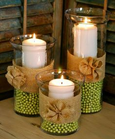 Spring Hurricane Vases/Burlap Rosettes---These would be cute for a country wedding, centerpieces. Diy Candle Centerpieces, Diy Candles, Burlap Candles, Wedding Centerpieces, Fall Candles, Centerpiece Ideas, Ideas Candles, Thanksgiving Centerpieces, Flameless Candles