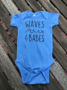 Waves and babes onesie. Beach Babe. Beach Baby. Cute baby onesies.  I use only high quality apparel, high quality heat transfer vinyl and a heat press to ensure longevity.  I stock Carters or Gerber White onesies. Other colors may take longer to ship: Rabbit Skins brand  Vinyl colors: White, black, gold, silver  Please message me with any questions.  waves and babes design © LullaBaby wear & gifts
