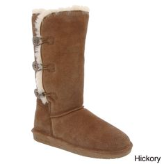 Featuring a triple toggle closure, it's easy to pull on and off these mid calf snow boots by BearPaw. Made of Cow suede and padded souls, these comfortable boots are available in chocolate and hickory