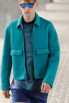 WGSN // Neoprene jacket pops in a bright turquoise hue against a back drop of deep navy, two-tone blue and metallic finishes #SS14 #PhillipLim #LindaFarrowGallery #LindaFarrow #Sunglasses #Menswear 【Discover more at www.lindafarrow.com】