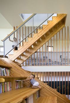 Architect Moon Hoon recently designed the Panorama House (scroll down), in Chungcheongbuk-do, South Korea. One of the most unique features incorporated into the home is a wooden slide built directly into a library which also functions as a stair-stepped home theater seati