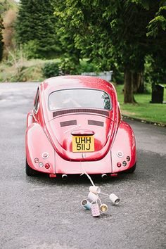 red vw beetle wedding car