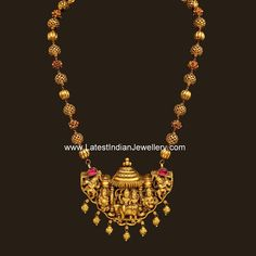 Artistically crafted nagas gold haram from Vummidi jewellers with gold balls chain linked to nakshi work Shiv Parivar gold pendant attached to gold ball drops. Gold Temple Jewellery, Men's Jewellery, Designer Jewellery, Jewellery Designs, Gold Earrings Designs, Gold Designs, Gold Jewelry Simple, Beaded Jewelry, Pearl Jewelry