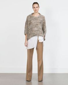Image 1 of PONCHO WITH THREAD DETAILING from Zara