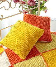 Knit these easy cushions to coordinate with the Sunshine Patchwork Throw, or in any colour you desire!
