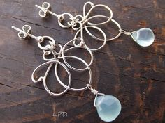 Lotus flower. Sterling silver and AA aqua blue chalcedony. by LovePotionDesign, via Flickr