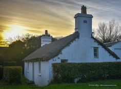 The Lhen - Sunset at this traditional gorgeous old Manx Cottage at the Lhen.  It is called 'Yn Thie Thooit' which translates to 'The Thatched House' Peter Killey - www.manxscenes.com