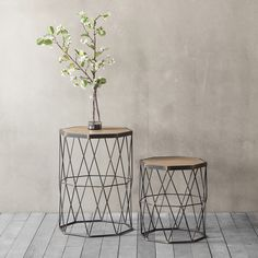 set of two octagon shaped metal based side tables with a geometric design and wooden tops