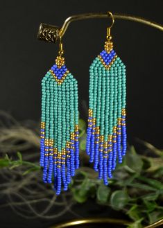 Turquoise beaded earrings Long beaded earrings Native American style earrings Own design. Only handmade. Measurements: Length - 3.85 inch Width - 0.78 inch Materials: Seed beads Nylon Thread Please if you have any questions please contact. If you need to change the size or color