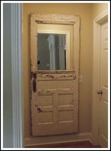 Making an Old Door Into A Unique Mirror...mounted with large picture hangers into the door itself and into studs