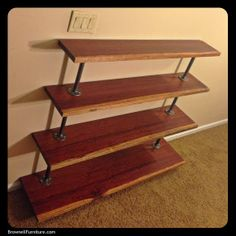 """CANTILEVERED BUBINGA BOOK SHELF: massively dense 8/4 bubinga shelves with sapwood edge supported by 3/4"""" steel pipe and flanges. 54"""" wide x 48"""" tall x 14"""" deep."""