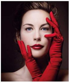 Liv Tyler. She is so beautiful anyway, but the red gloves and red lipstick make this one even more picturesque.