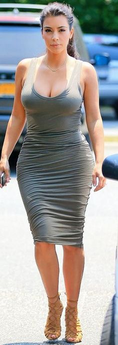 Who made Kim Kardashian's gray ruched tank dress and brown lace up sandals?…