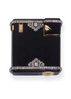 A BLACK ENAMEL AND DIAMOND LIGHTER, BY CARTIER  Of square form with diamond geometric motifs and border, 3.0 cm. square, with London hallmark for 18k gold, 1932 Signed Cartier London