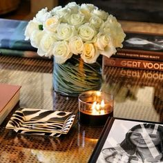 Favorite things for a Tablescape, flowers books and trays, zebra of course for graphic design...k