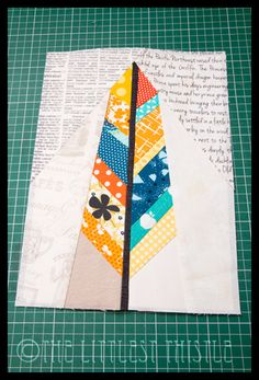 Paper Pieced Feathers - The Littlest Thistle...  I decided on the paper piecing because I'd read of a number of other people tearing their hair out trying to make the pieced section of the feather fit on the template,