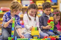 kids building block together