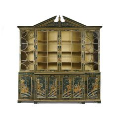 A George III and later decorated breakfront library bookcase  in green and gilt chinoiserie japanning, the upper section with adjustable shelves, the base with a central cupboard enclosing static shelves, the flanking cupboards with adjustable shelves, later decorated