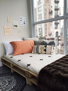 DIY pallet window seat. Going to try this with a bookshelf next to it in my re-decorated room!!
