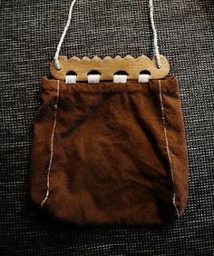 Reconstructed woolen pouch with wooden handle that is based upon an artifact found at Hedeby.  The wooden handle is sewn on with linen thread.