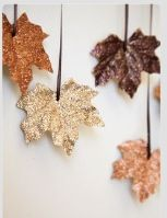 Glittered faux leaves hung as garland