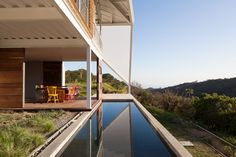 reflecting pool in modern house in el salvador with creative roofing
