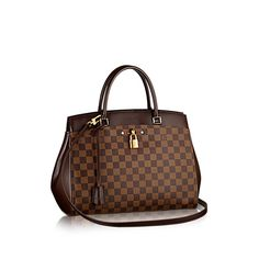 Discover Louis Vuitton Rivoli MM: Feminine, functional, impressive: the new Rivoli bag in Damier canvas reflects the elegant businesswoman for whom it was designed. Like her, the Rivoli inspires confidence. Its distinctive shape combines refined lines – note the rounded gussets – with such practical features as two outer pockets and a roomy interior that easily holds A4-size documents. The Rivoli can be carried by hand, over the elbow or, with the removable leather strap, on the shoulder.