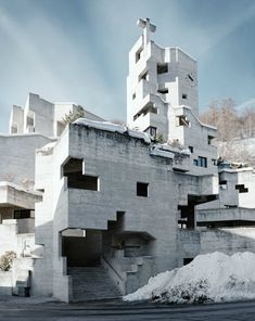 Modern concrete and wood church by Walter Maria Förderer.    i feel like this building is going to transform and attack me....